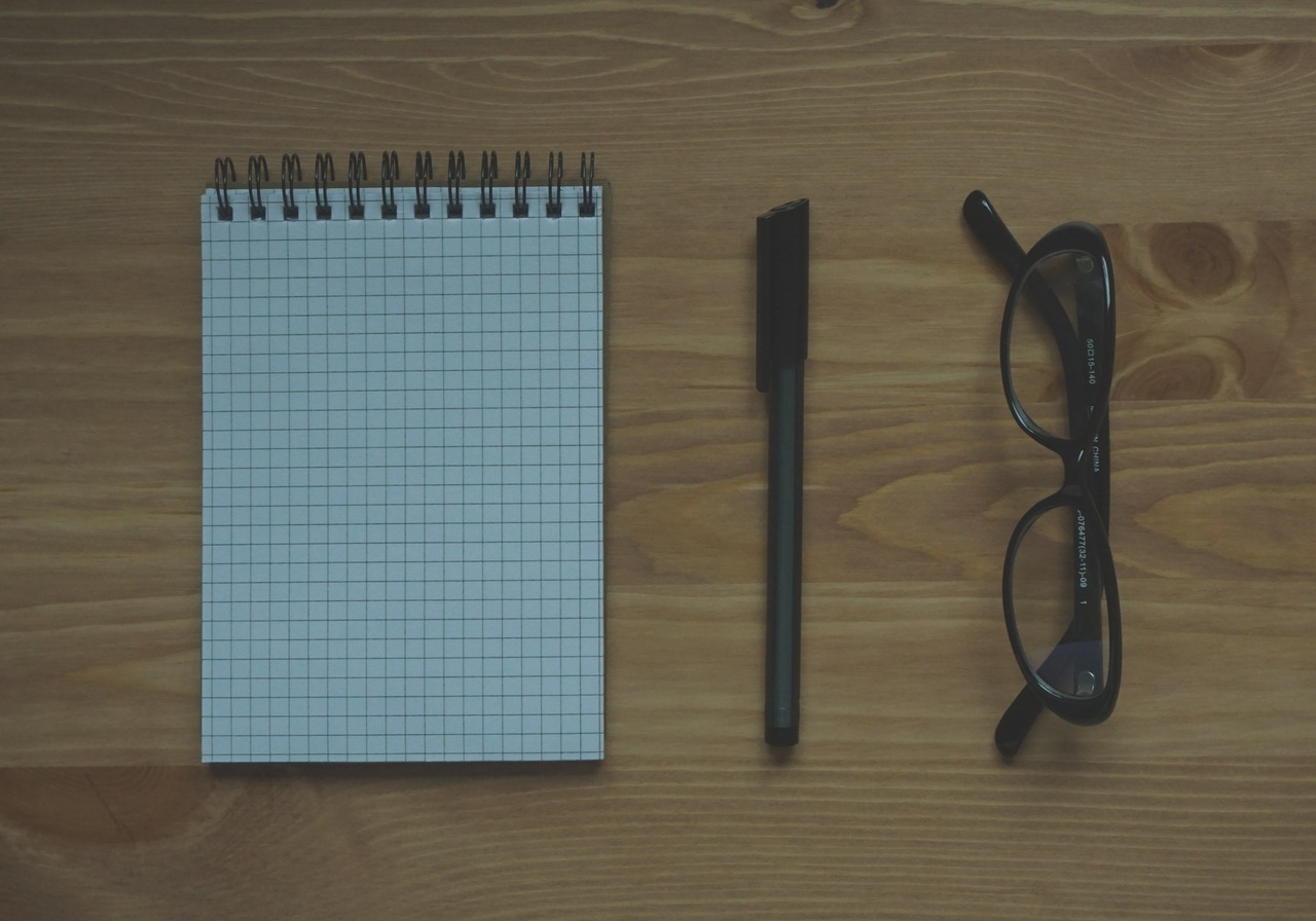 hipster glasses, paper and pen
