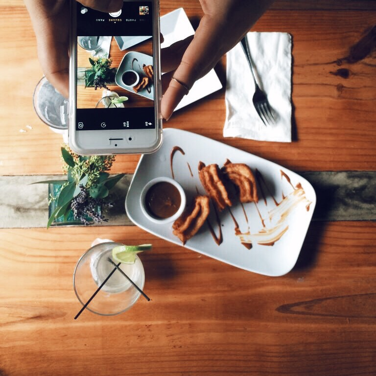 Taking a photo of a meal with mobile phone